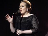 Adele compra mansões