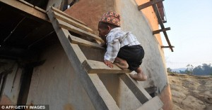Chandra-Bahadur-Dangi-has-to-climb-a-ladder-to-get-in-to-his-home-in-the-remote-Reemkholi-village-in-Dang-district-540-kilometres-southwest-of-Kathmandu